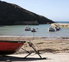 Port Isaac's working harbour, on the doorstep of Latitude 50's Homer Park, a self-catering property in Port Isaac, Cornwall