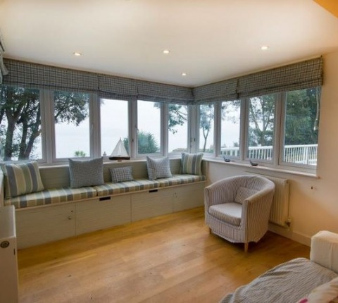 A room with a view; a different perspective on the sitting room at Tomhara, a Rock holiday cottage, Cornwall