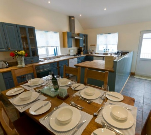 Dining area and Kitchen area at Cribba Cottage, Port Isaac, Cornwall