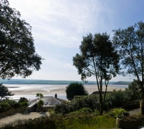 Stunning, waterside views from this Latitude 50 luxury self-catering holiday cottage in Rock, Cornwall