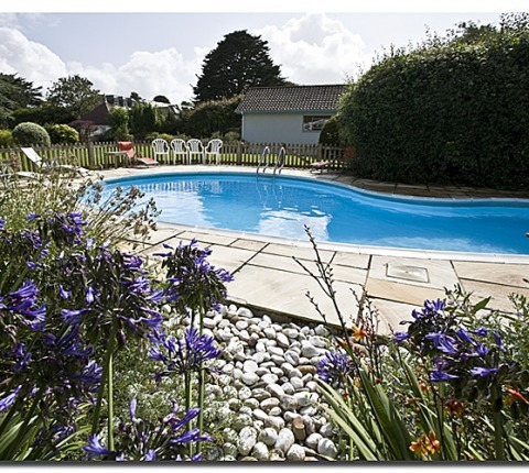 Some Cornwall Beach Cottages have outdoor heated swimming pools; see Latitude 50