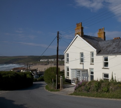 No 1 Pentire View, image taken from its side elevation, showing its proximity to Polzeath Beach