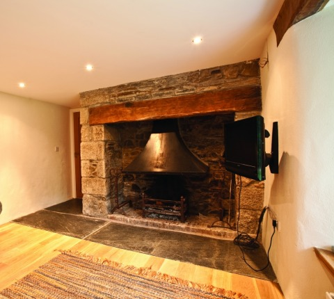 Penquite Cottage, inglenook fireplace (sitting area off open-plan kitchen/dining)